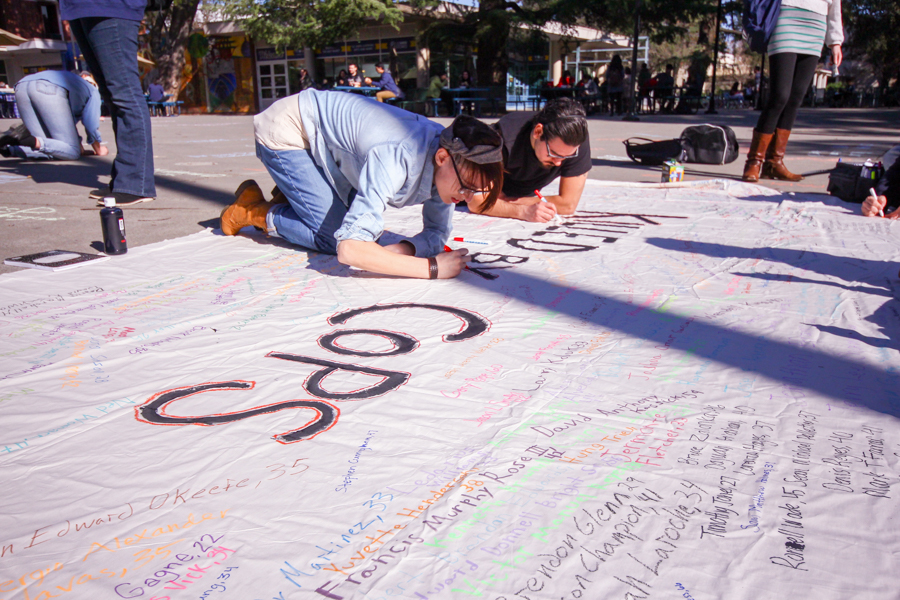 Students rewrite names of police brutality victims as part of 'Say Their Name' protest