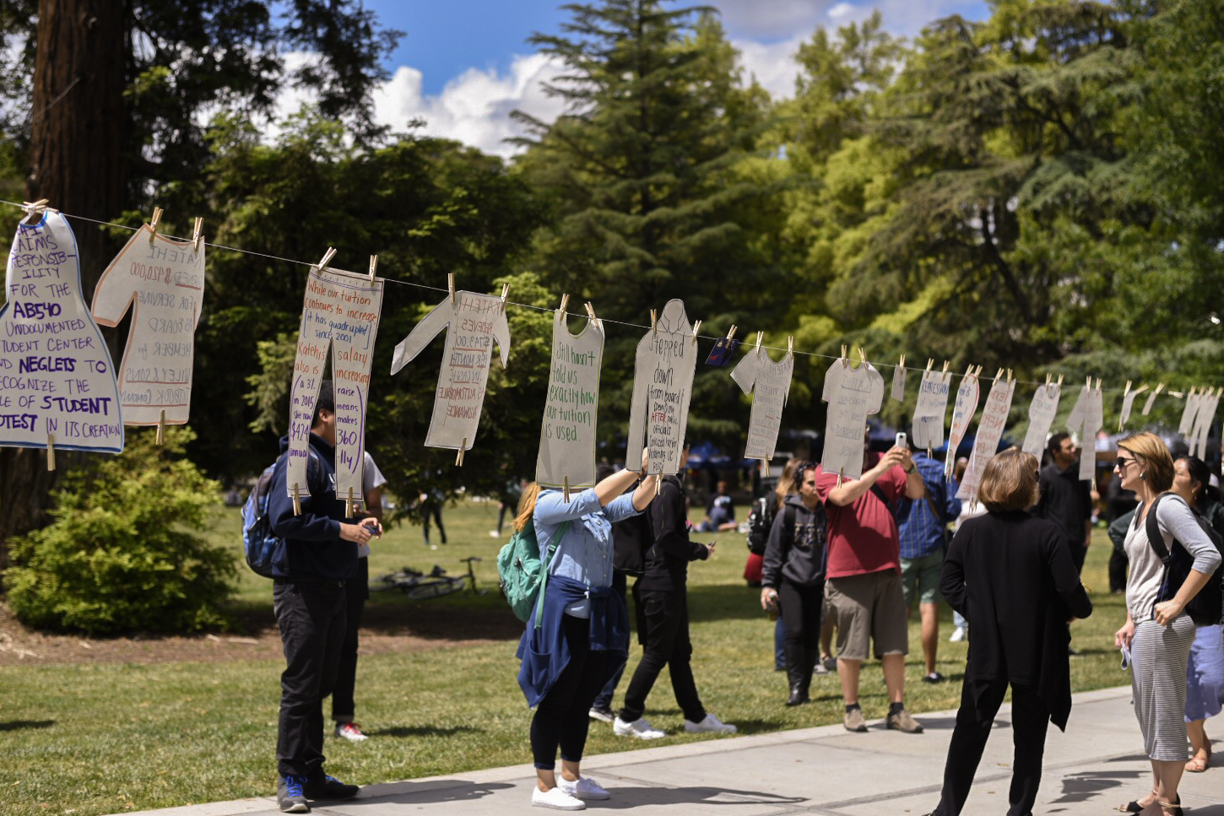 Fire Katehi demonstrators air chancellor's metaphorical dirty laundry at Katehi's Kloset exhibit