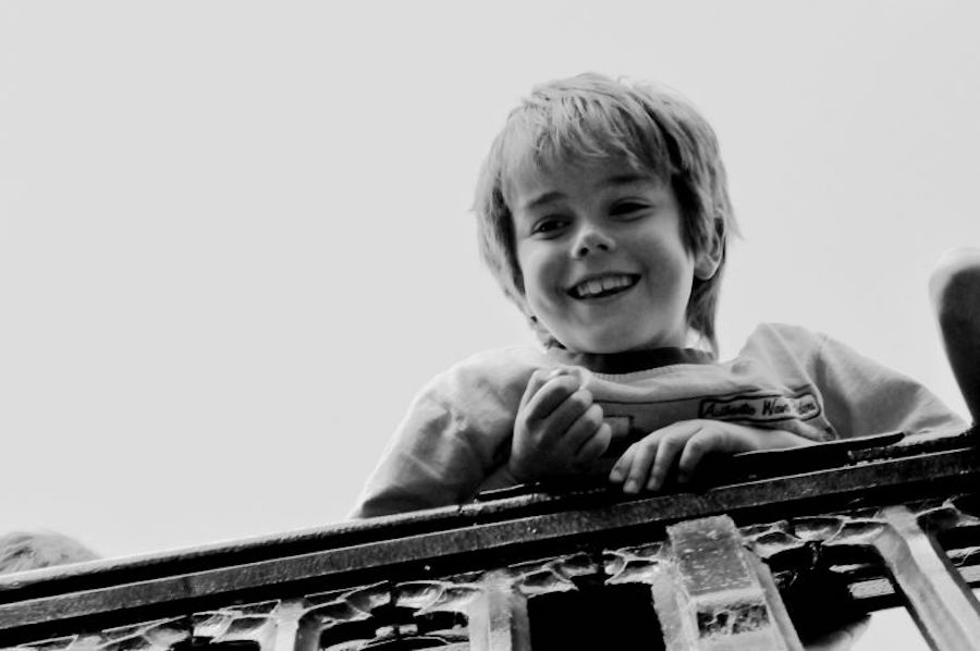 This photo was taken in Cambridge when I was in high school. During the punting tour, I was taking photos of people on the bridge and suddenly found this little boy smiling at me. I caught that moment and realized how photography can fix time at a beautiful moment in our life. (ZHEN LU)