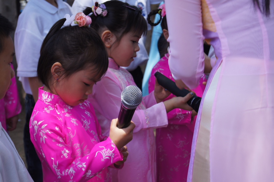 This is my favorite photo because it was from the opening day of a Buddhist temple that my dad built. It reminds me of when my parents would dress me up in traditional gowns, called Ao Dai, for special events, like this one. (BRIANA NGO)