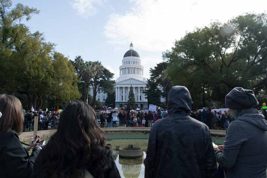 The area in front of the California State Capitol fills with people who watch on as people directly in the front of the building begin chants. (BRIAN LANDRY / AGGIE)