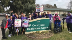Davis Courtyard Healthcare Center workers picket for better wages, benefits