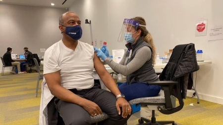 UC Davis Chancellor Gary May receives vaccination, encourages people of color to trust vaccine