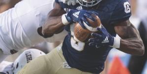 Aggies fall in ranked clash